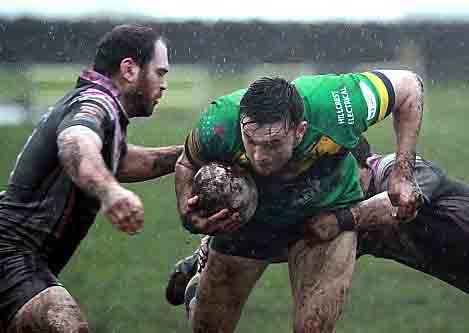 RAIN MEN . . . Oldham RL�s Paddy Mooney finds a gap in the South Wales Scorpions line. PICTURES: IAN LOVELL