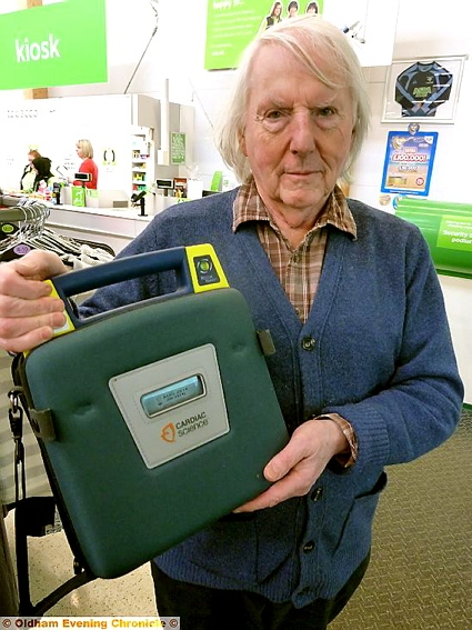 POTENTIAL lifesaver: Councillor Alan Roughley with a defibrillator unit