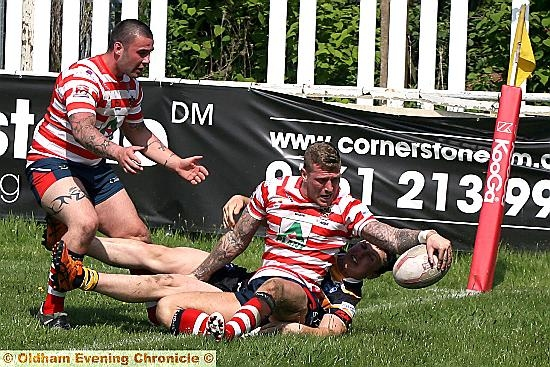 FLOORED: a York City Knights opponent is unable to prevent Oldham�s Dale Bloomfield from touching down.