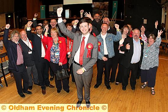WE did it . . . Council leader Jim McMahon celebrates with his Labour colleagues