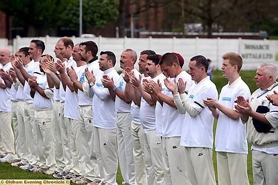 A BIG hand for Trevor: players take part in a minute�s applause at the charity match