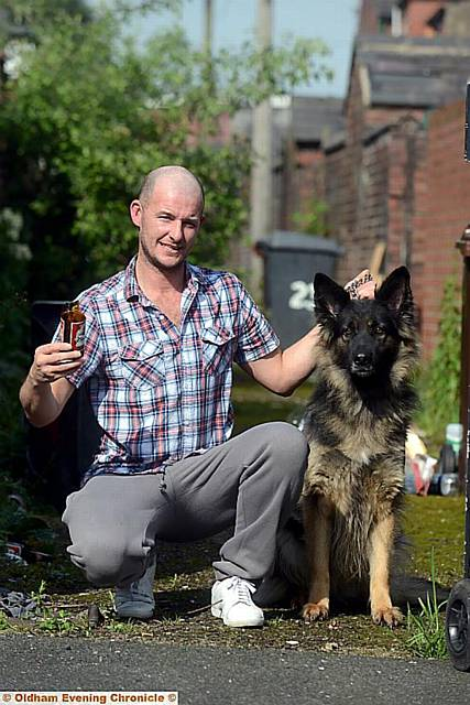 John Badby and his dog Mazie, who was injured by broken glass.