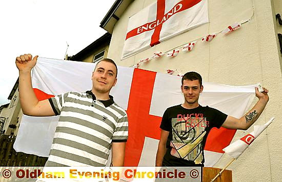Jamie Robinson and Ryan McCallion fly the flags in Delph Lane, Delph.