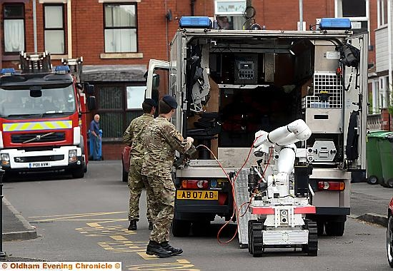 Bomb disposal experts prepare to check out the find