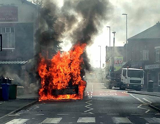 The bus well ablaze on Park Road, Glodwick.