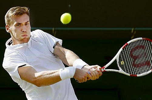 DANIEL Smethurst returns a John Isner serve.