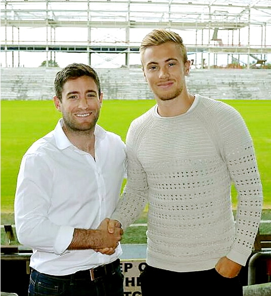 NEW ARRIVAL: Joseph Mills is welcomed by team boss Lee Johnson