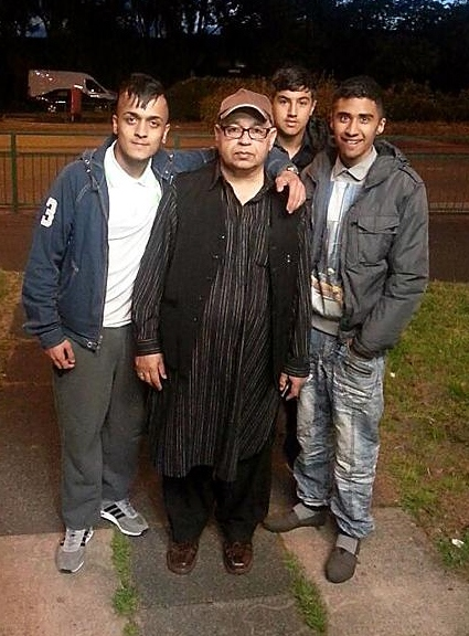 Junaid Khan�s father Mumtaz Khan (father) with friends at the vigil.