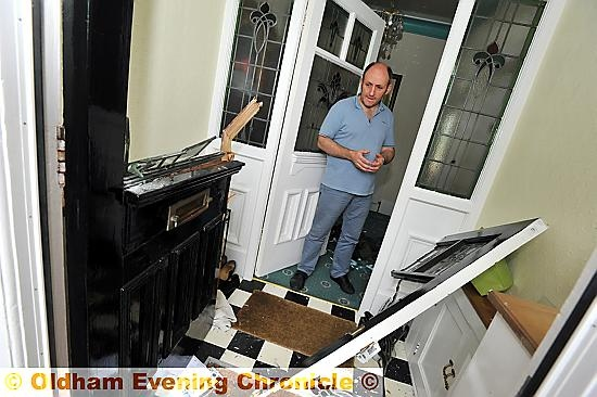 Gary Schofield at his smashed in front door in Garden Suburb.