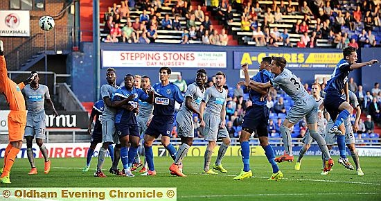 Timothee Dieng (third right) scores from a corner.