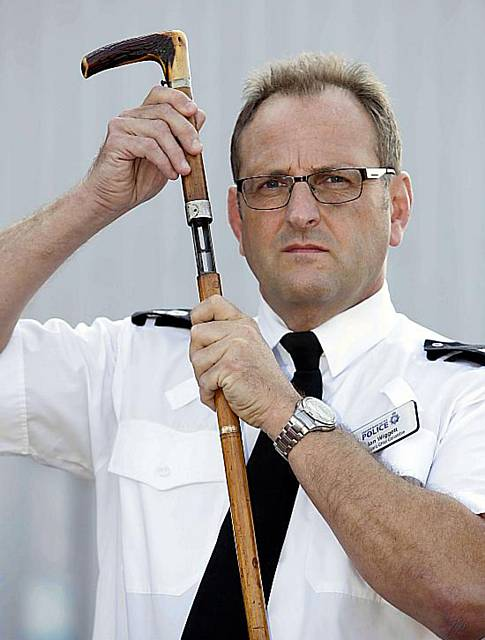 Shotgun disguised as walking stick handed in to GMP. Pictured Assistant Chief Constable Ian Wiggett