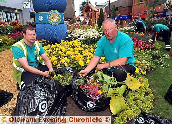 Andrew Marsland (gardener) and Lee Gannon (Bloom and Grow Team Leader) with bags of destroyed plants.