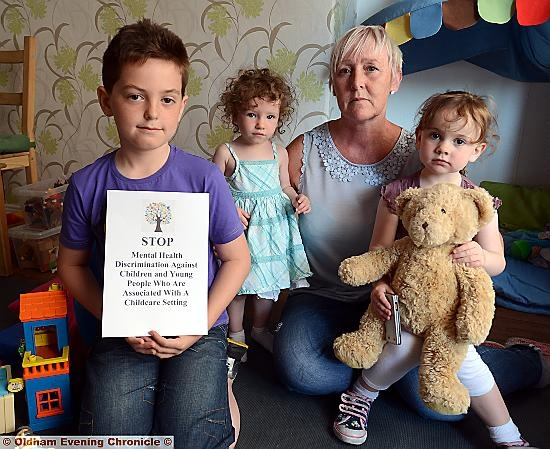 Childminder Susan Radcliffe is worried that she may have to stop looking after children. Pic with some of her charges left to right, Archie Green (8), Melody Topham (20 months), Abbie Irvine (3).