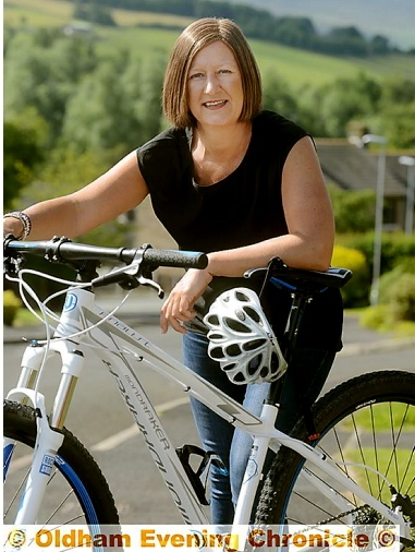 SADDLING up: Jo Taylor gears up for a 60-mile bike ride during her chemotherapy treatment