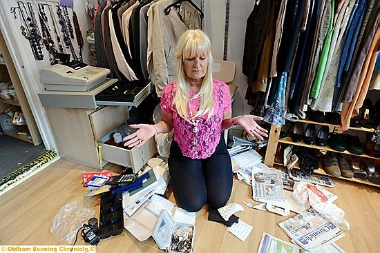 Pennine Pen manager Karen Dissington in the vandlaised charity shop on Ashton Road