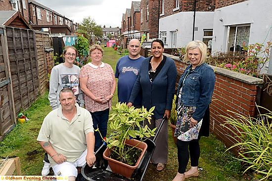 Neighbours from Mather Street and Dalton Street in Failsworth have transformed their shared alley into a local beauty spot, Malton Garden. From left, Bernard Roscoe (kneeling), Stacey Byrne, Sonia Chapman, Carl Crawford, Cheryl Brock, Penny Kenworthy, Failsworth and Hollinwood district team