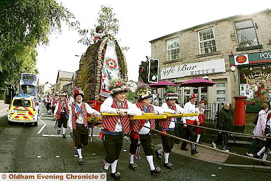 HIGH and mighty . . . the rushcart parades through Uppermill