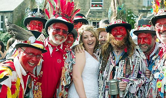 BRIDE Vicky with members of the Morris Men.