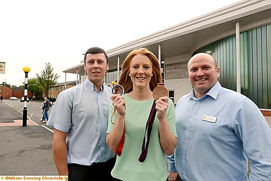 CENTRE OF ATTENTION: Olympic and Commonwealth medal-winner Nicola White meets Chadderton Wellbeing Centre staff Manus Twomey (left), facility manager, and head of customer relations Peter Howson.