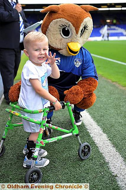 Leo Stott with Chaddy the Owl as he leads latics out against Huddersfield Town