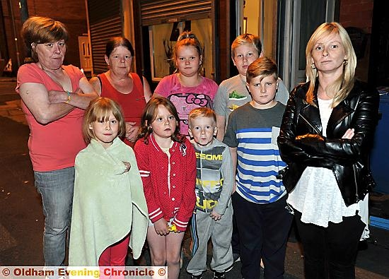 Lisa Casey (right) with her children and neighbours.
