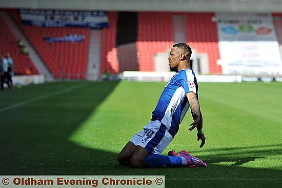 WHAT A FEELING . . . Jonson Clarke-Harris celebrates his first goal of the season at Doncaster.