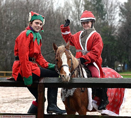 Kirsty Fielding and Ellie Stansfield dressed as elves with horse Maggie