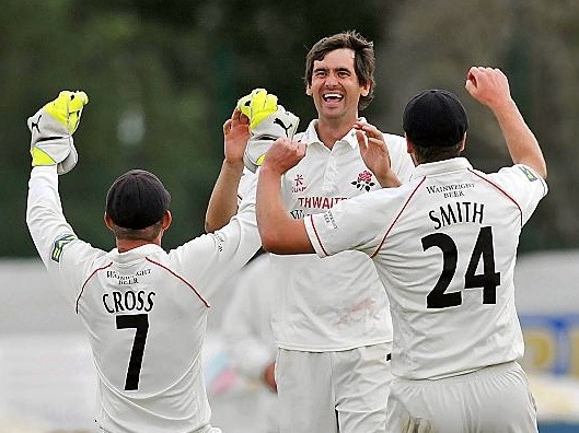 Kyle Hogg (centre) celebrates another wicket in his playing days