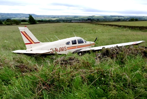 The damaged plane ended up in a field