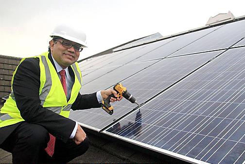 Market goes green . . . Councillor Abdul Jabbar with the solar panels that will save £9,000 a year in Tommyfield electricity bills