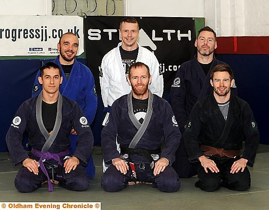 HEADING FOR PORTUGAL . . . Stealth Brazilian Jiu-Jitsu Club members, from left to right, back: Roberto Mura, Peter Wilson, Phil Russell. Front: Nemil Malczewski, Steve Campbell, Jake Corrigan.