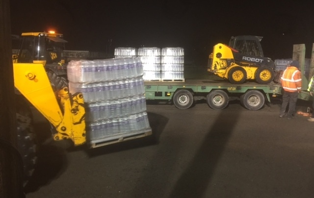 UNITED Utilities staff load water on to lorries at 5am today