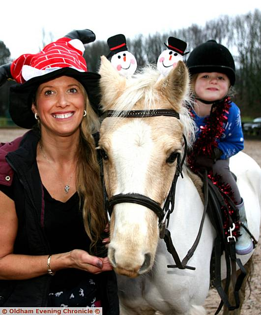 CAROLINE Platt, with her daughter, Savannah Platt, aged four, with her horse, Dan