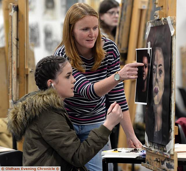 Oldham Sixth Form College, Oldham. Portrait artist Stefanie Trow working with students. Pictured here are student Lilly Maloney-De Leeuw Van Weenen (16) with artist Stefanie Trow.