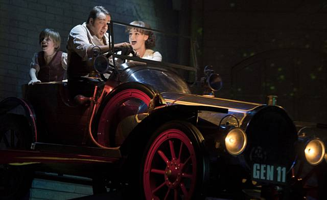 ON THE MOVE . . . Jeremy Potts (Henry Kent), dad Caractacus (Jason Manford) and Truly Scrumptious (Charlotte Wakefield) take a spin in Chitty.