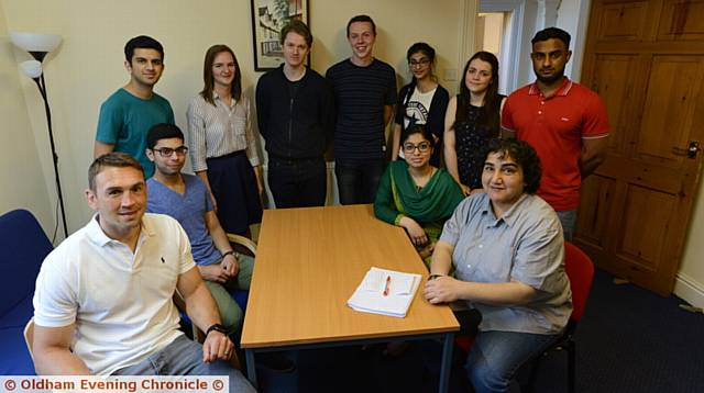 Kevin Sinfield, left, and refugee Marzia Babakarkhail, right, meet students at the summer school