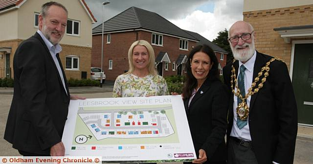DEVELOPMENT . . . (from left) Matthew Harrison, chief executive of Great Places housing group; Lisa Westerman, group head of sales; Debbie Abrahams, MP for Oldham East and Saddleworth; and Oldham Mayor Councillor Derek Heffernan at Leesbrook View