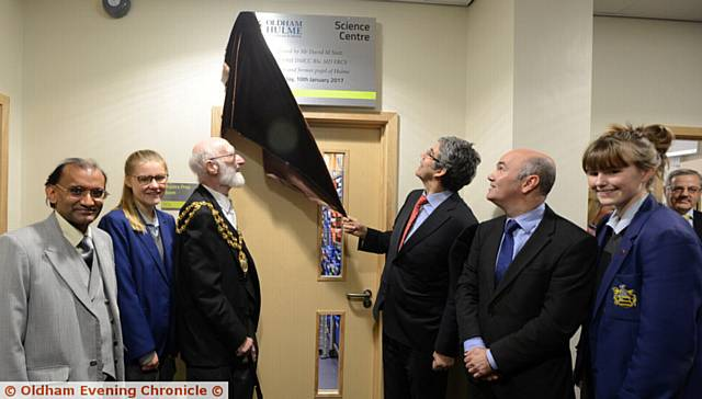 OPENING ceremony . . . Mr Nott unveils the plaque watched by, from left, Vijay Srivastava (chairman of governors), Daisy Hilton, Oldham mayor Councillor Derek Heffernan, David Nott, Craig Mairs (principal) and Mia Robinson
