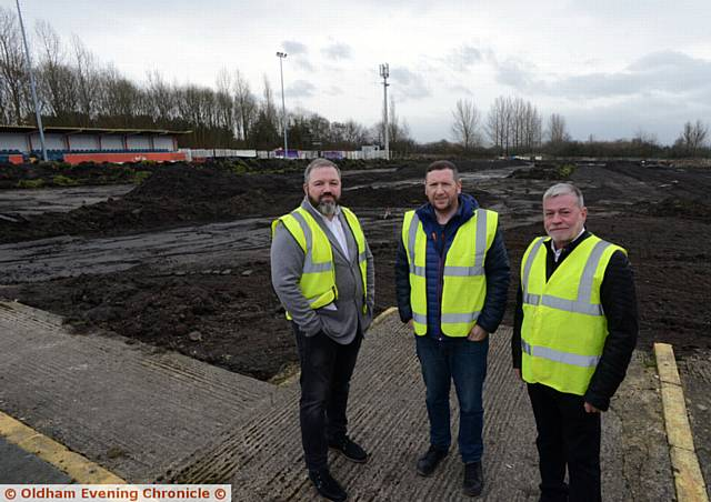 TAKING shape . . . Rob Fuller, centre, chairman of Avro FC checks on progress at the newly-named Vestacare Stadium with Norman Lowrey (left), Vestacare managing director, and Danny Hughes Vestacare director