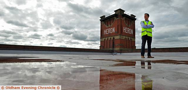 UP on the roof . . .  Craig Holden (group HR director) at Heron Mill which will be used as a distribution warehouse
