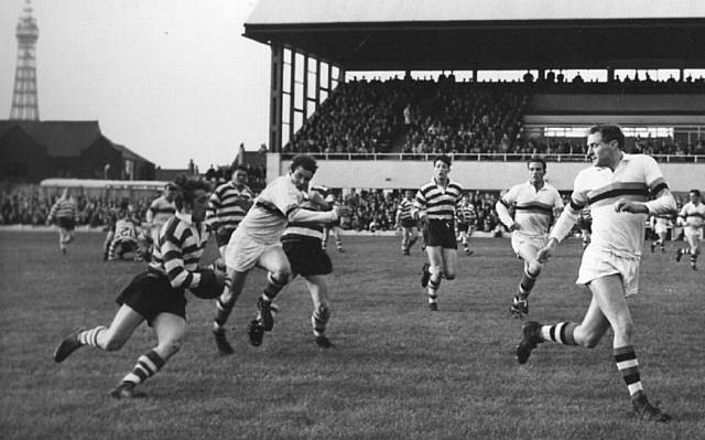 TOWERING PRESENCE . . . Blackpool's Alex Givvons (far right) tracks back to cover Oldham's Joe Collins in season 1964-65