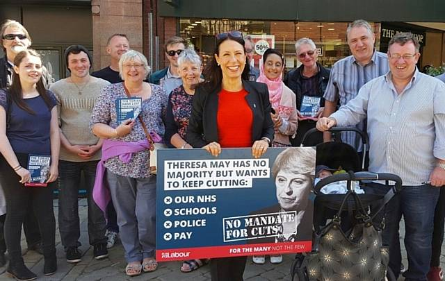 DEBBIE Abrahams MP set up a stall in Oldham town centre as she took part in the Labour Party's national day of campaigning against Government cuts
