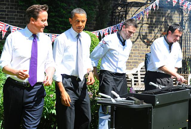 grilling . . . Graham (right), barbecues with then US President Barack Obama and Prime Minister David Cameron