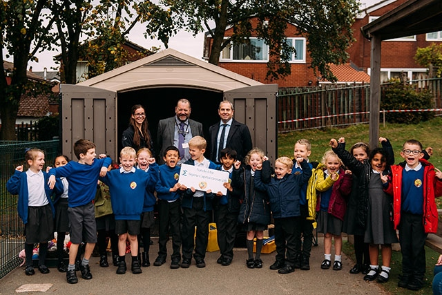 Pictured with school pupils are (left to right): Tiffany Chevis, Marketing Executive, Simple Life, Ian Mason, Headteacher, Mills Hill Primary School and Matthew Townson, Development Director, Simple Life.