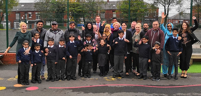 Parents, pupils and staff outside Clarksfield Primary