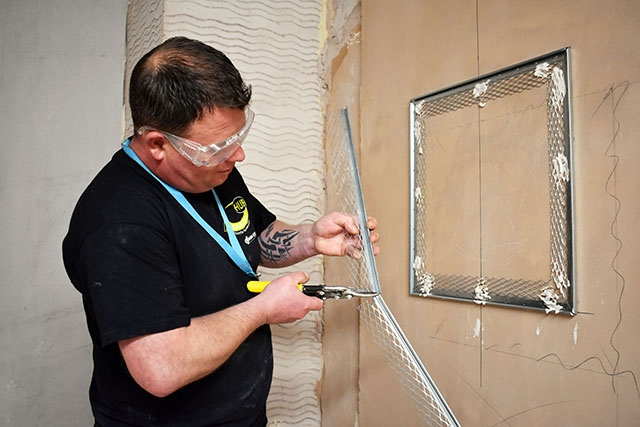 Stuart Smith learning plastering techniques at Hopwood Hall College