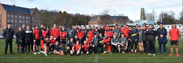 Hopwood Hall College students and Salford Red Devils staff and players line up