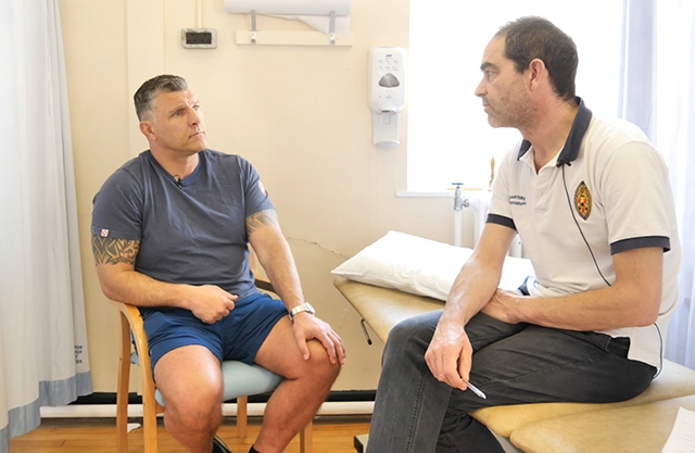 Barrie McDermott is pictured with Senior Physiotherapist Rob Conlon, who features in the videos