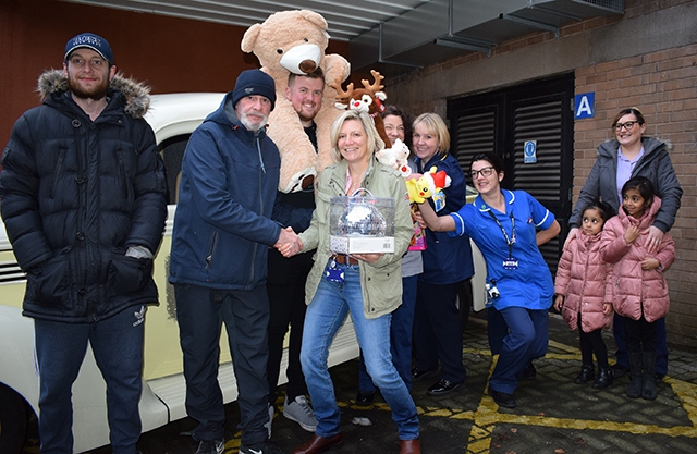 Pictured (left to right) are members of the Rainy City Cruisers hot rod car club with Penny Martin and staff from the Royal Oldham Hospital children's ward