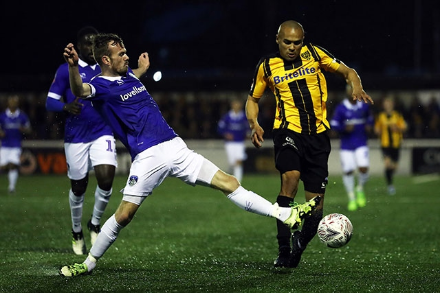 Action from Saturday's FA Cup win at Maidstone as Athletic's Cameron Dummigan (left) challenges Elliot Romain